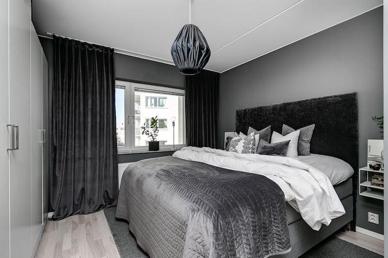 Makuuhuon ja harmaat tekstiilit